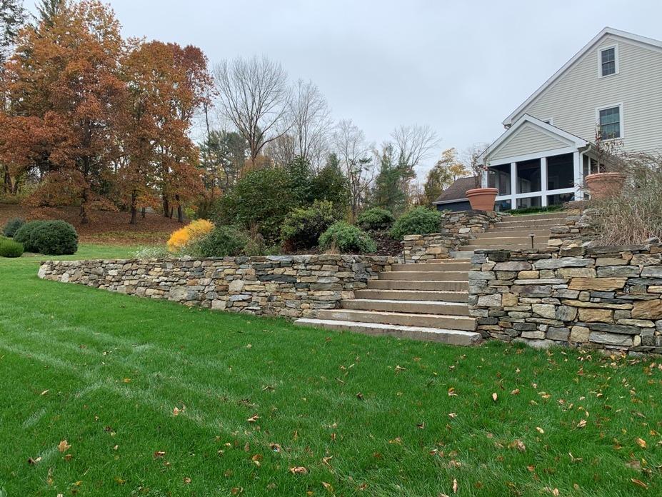 Fieldstone wall with granite steps
